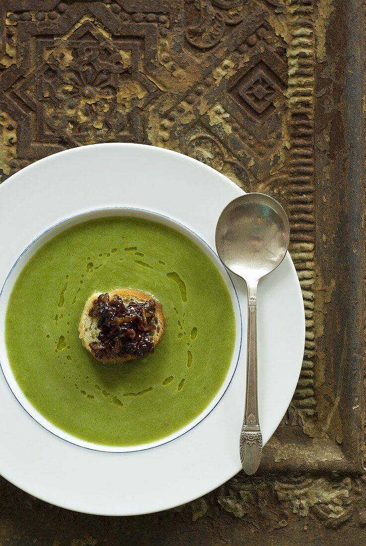 Wild leek soup with onion and bacon crostini
