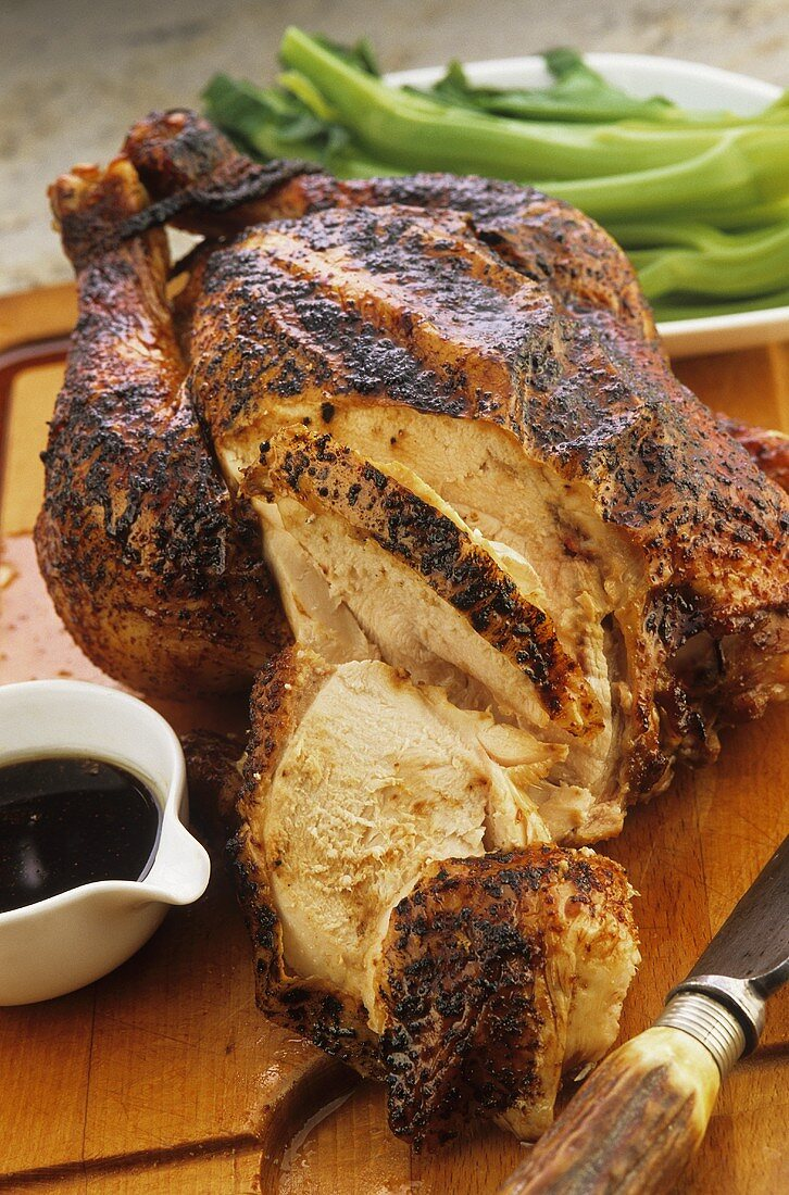Marinated roast chicken, partly carved (China)