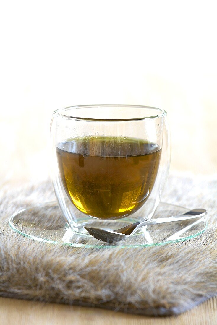 Mulberry tea in a thermo glass