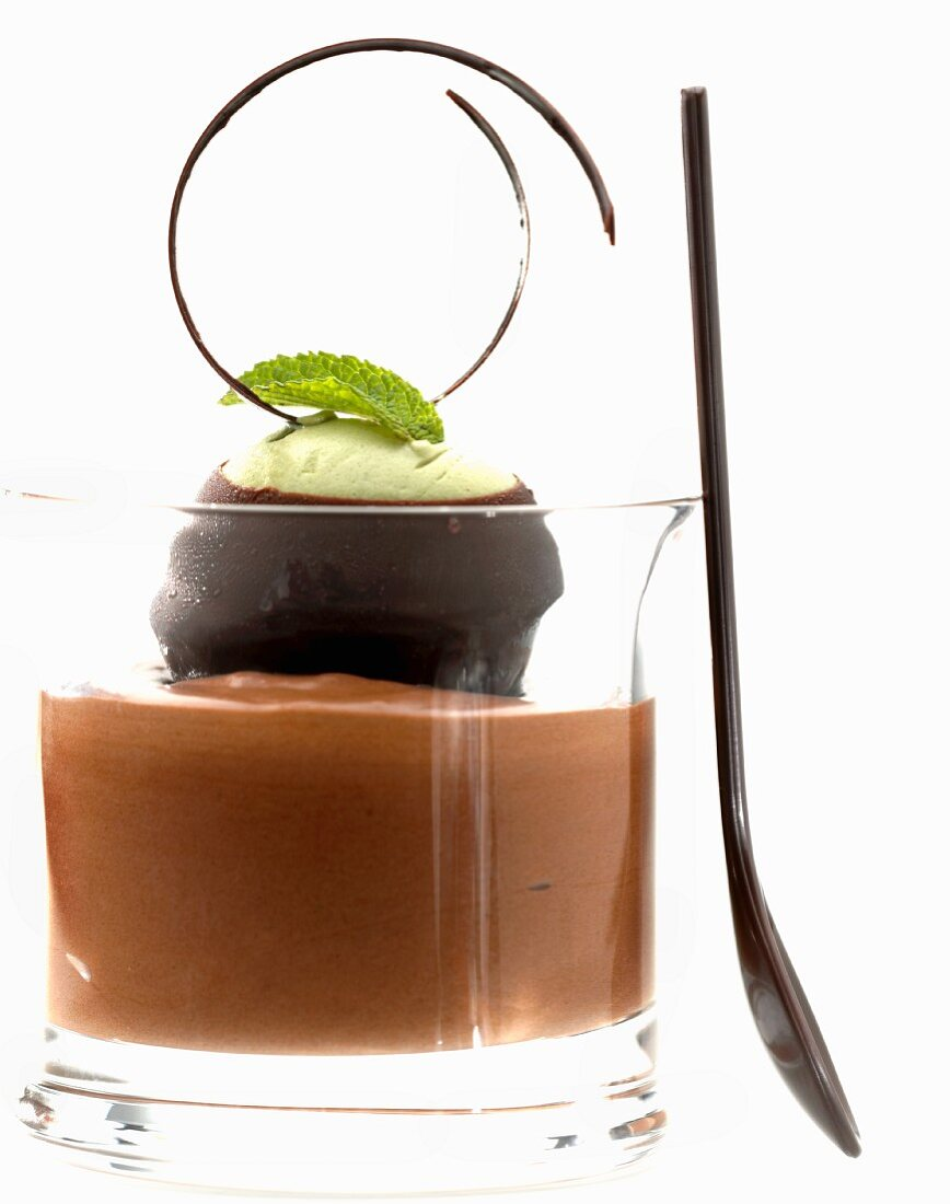 Green tea parfait wrapped in chocolate on chocolate cream
