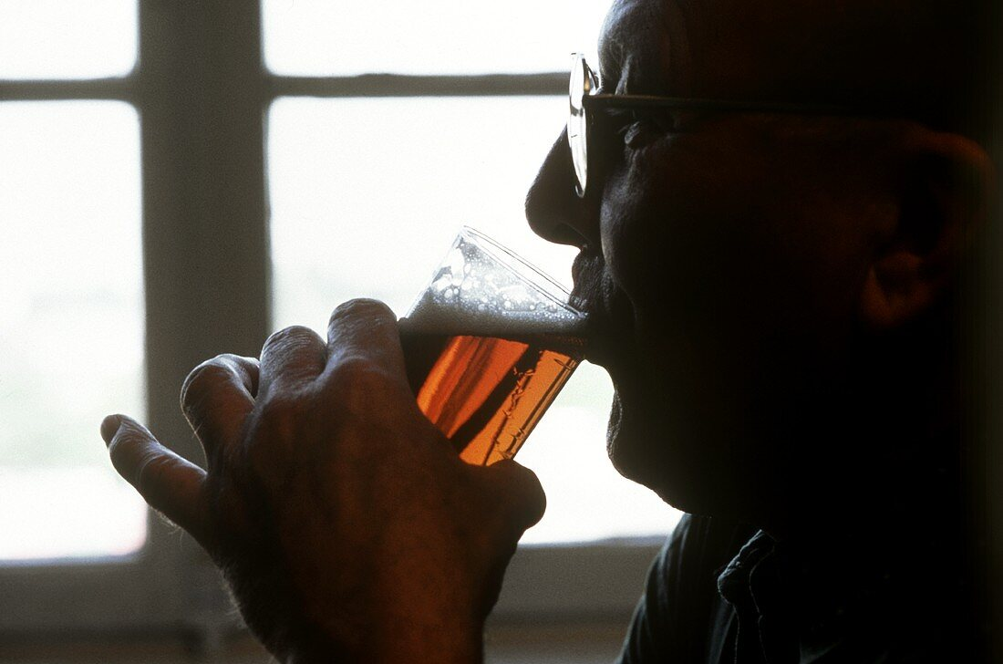 Man drinking a small Beer