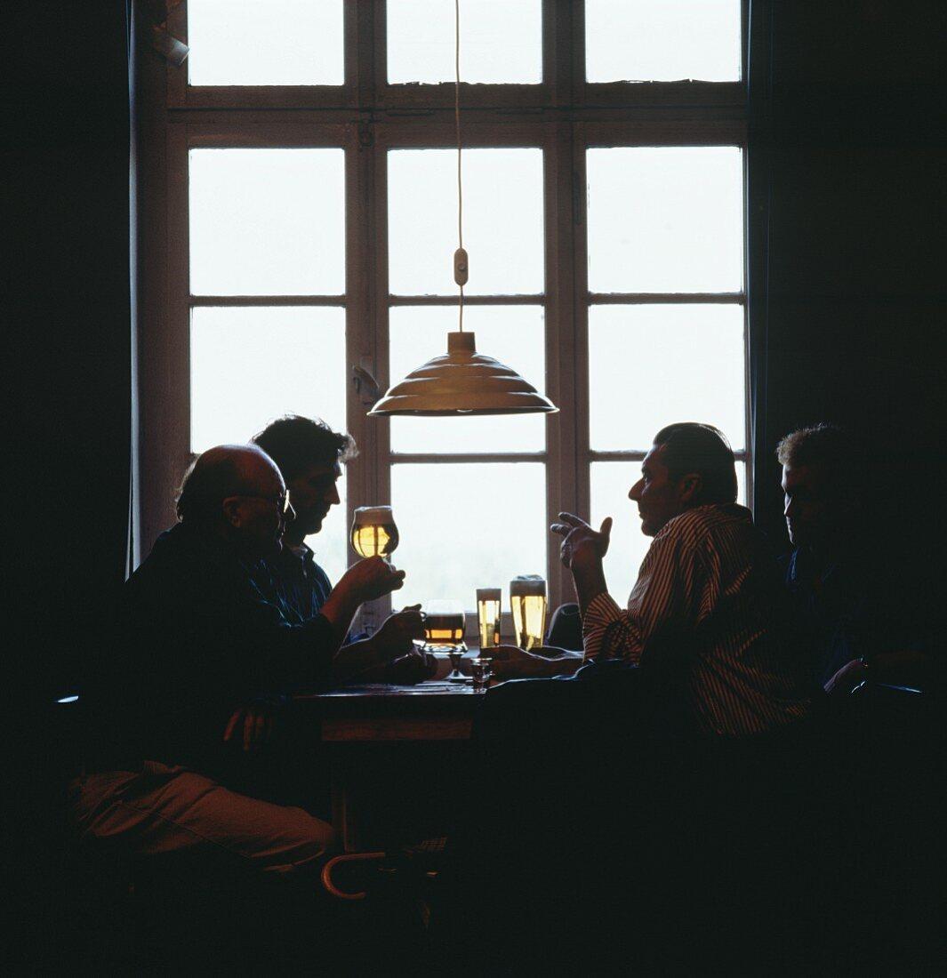 Men Drinking Beer at a Restaurant Table
