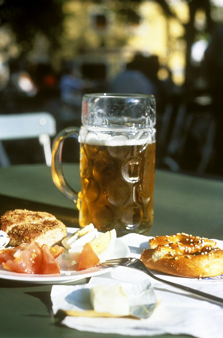 A litre of beer with pub lunch and pretzels