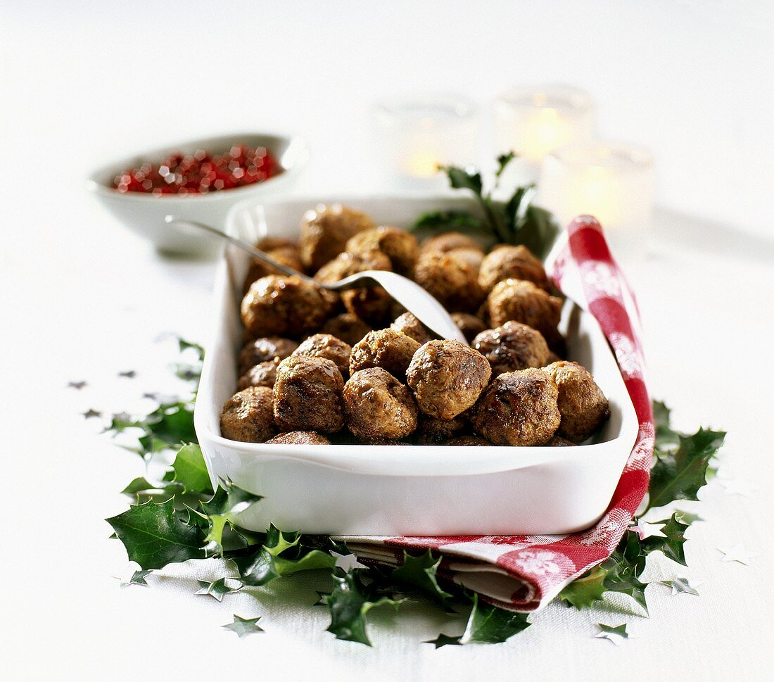 Meatballs in a baking dish with cranberries