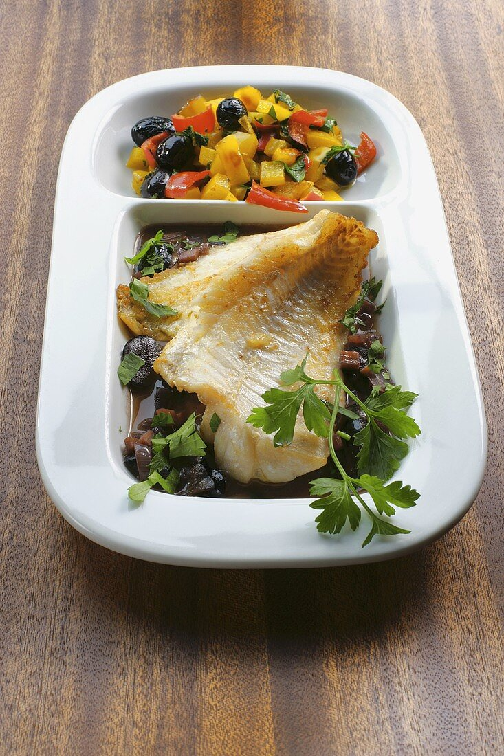 Fried redfish fillet with vegetables and parsley