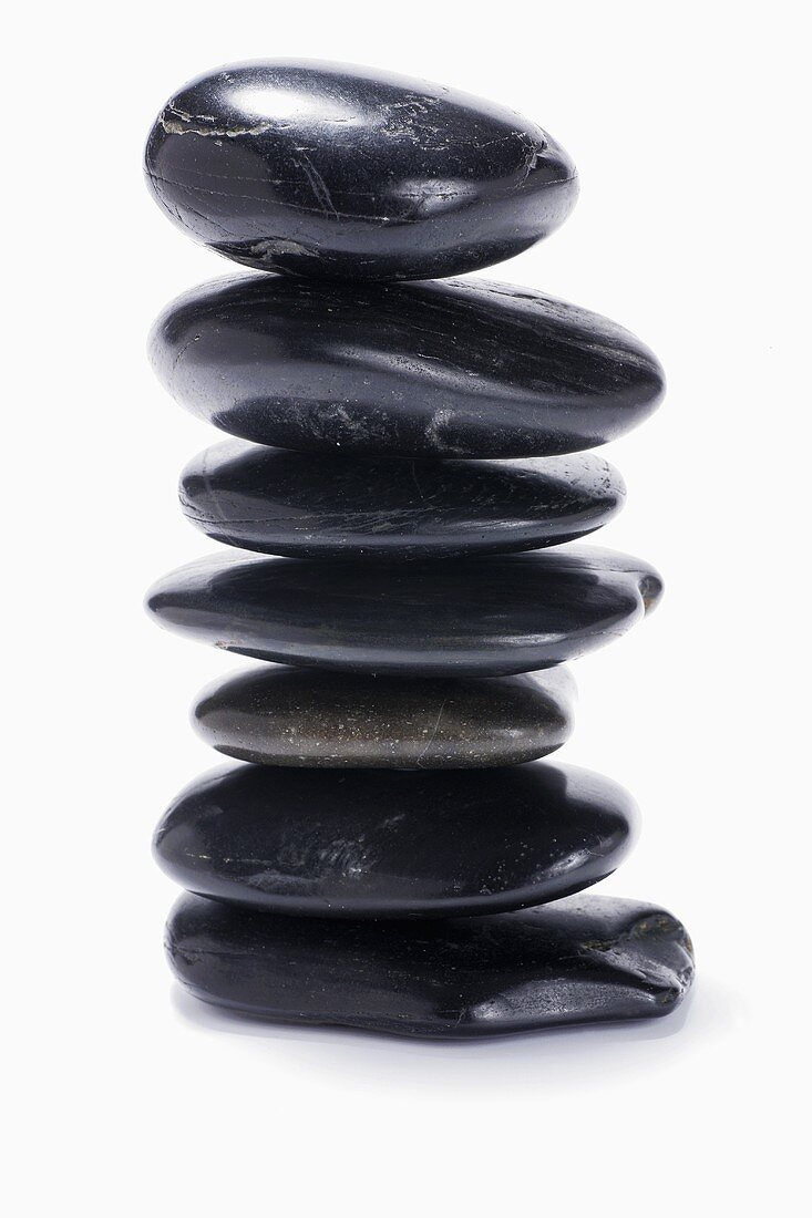 Black stones, in a pile, for LaStone Therapy