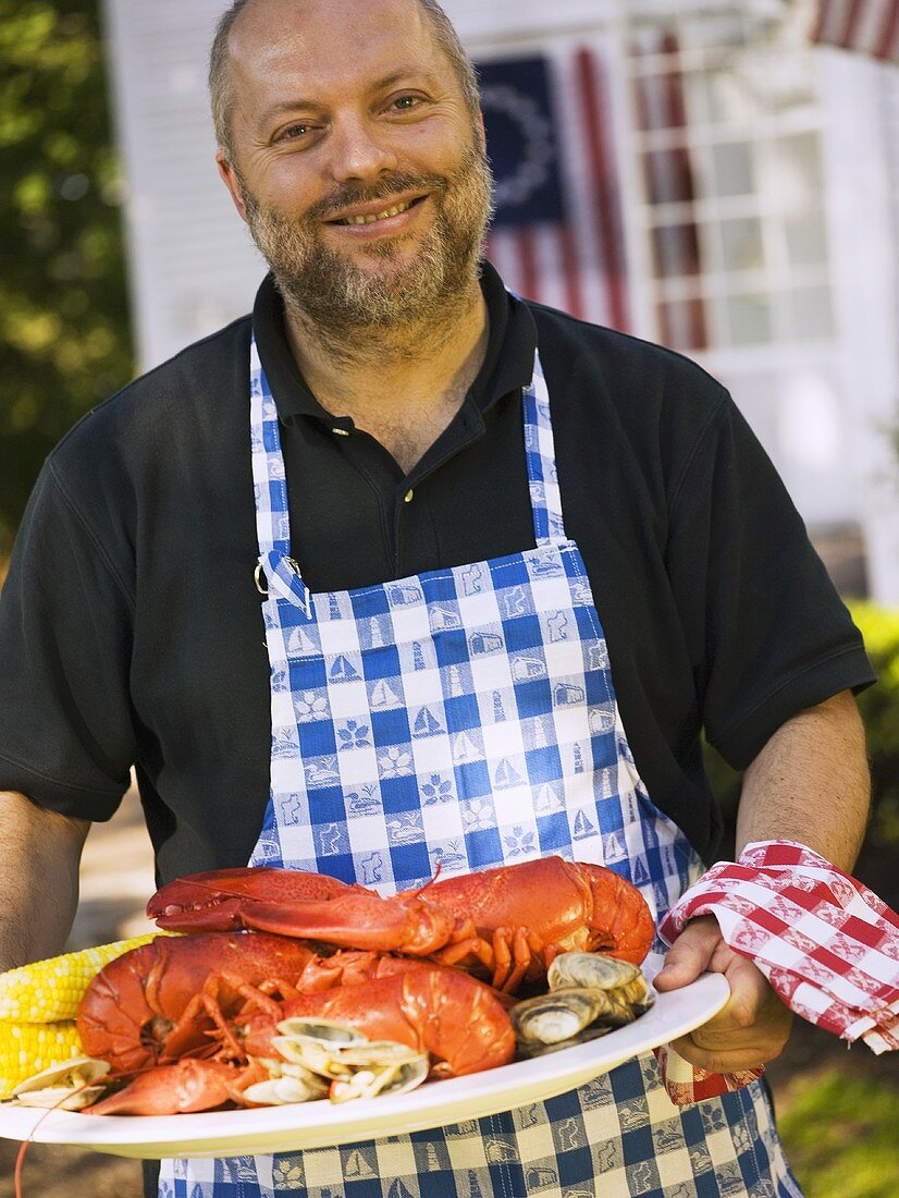 Man serving seafood platter for 4th of July (USA)