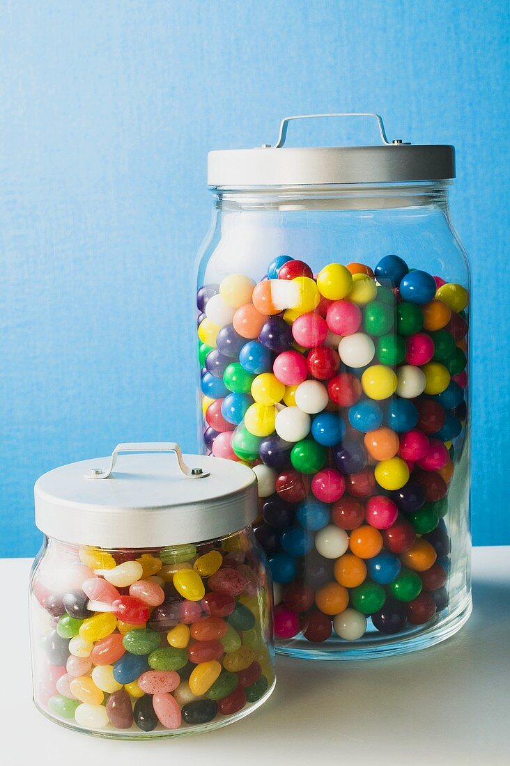 Coloured bubblegum balls and jelly beans in jars