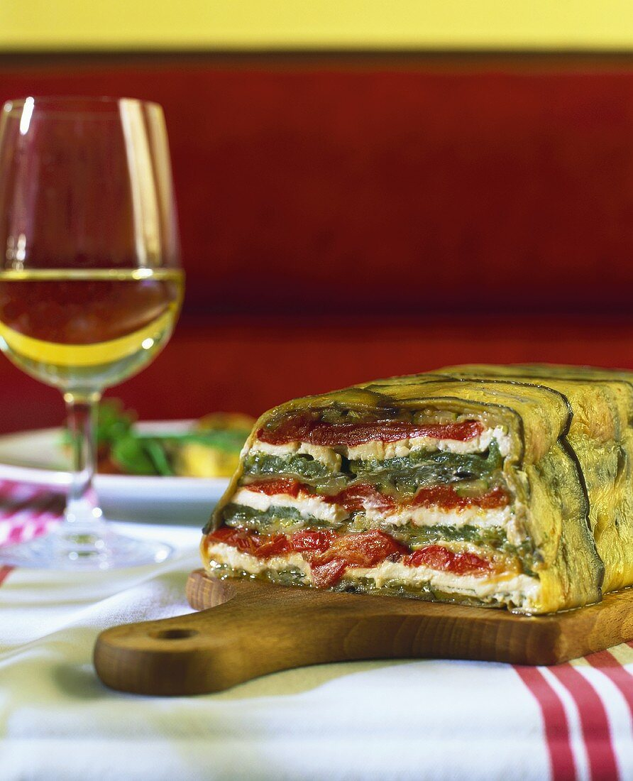 Goat's cheese and pepper terrine wrapped in courgette