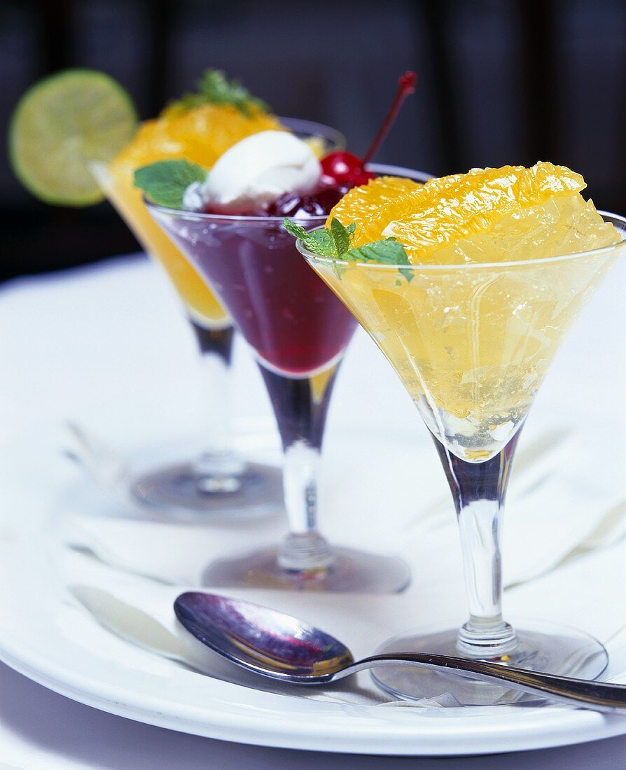 Fruit dessert with Martini in three glasses