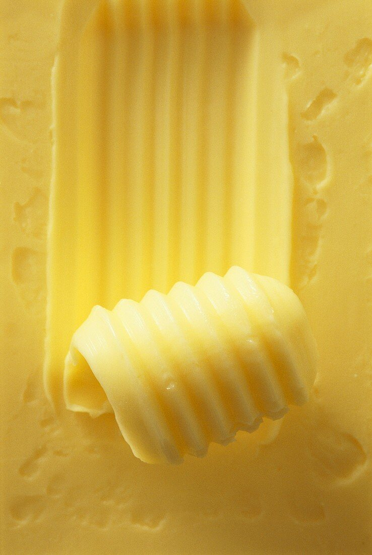 Butter with butter curl (close-up)