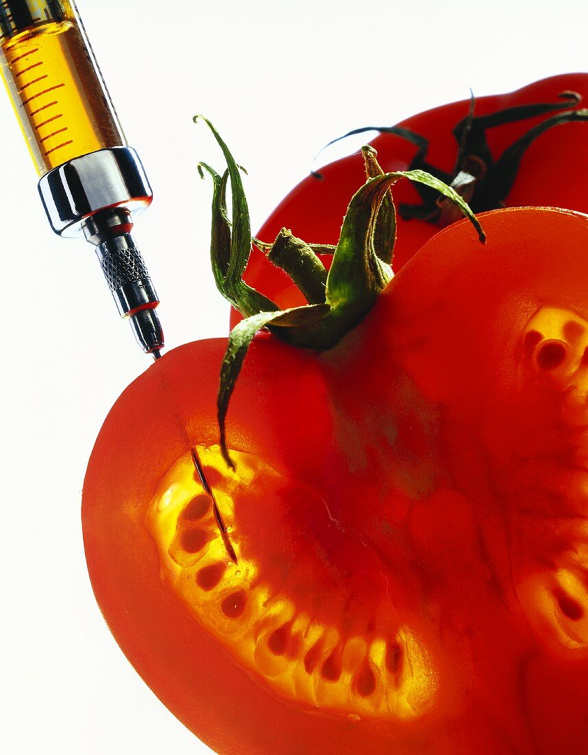 Tomato with syringe
