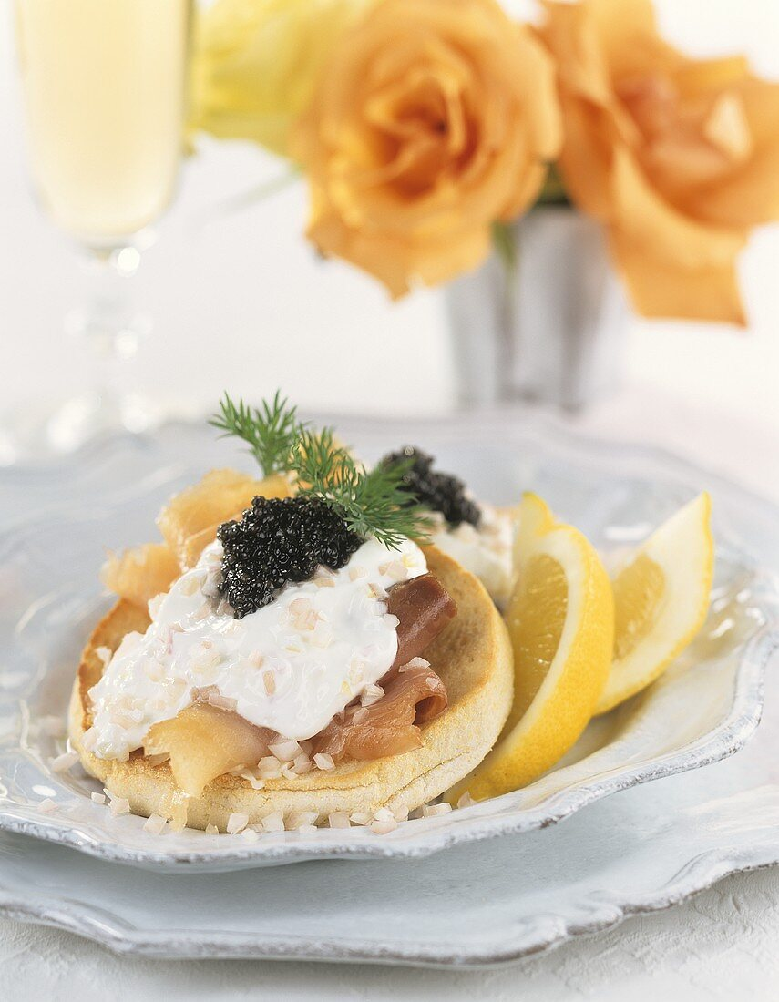 English muffin with smoked sturgeon and caviare
