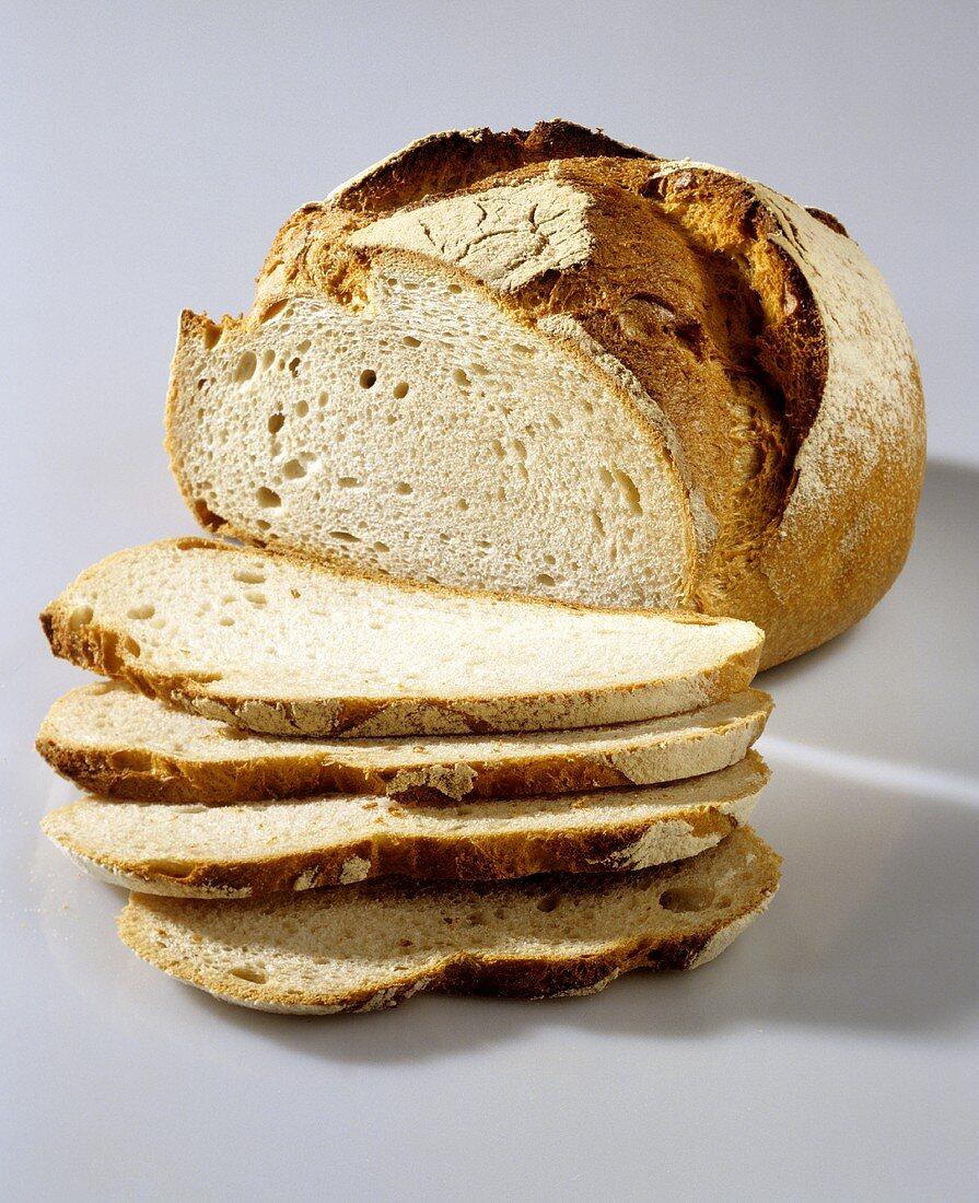 Round wheat-rye bread, slices cut