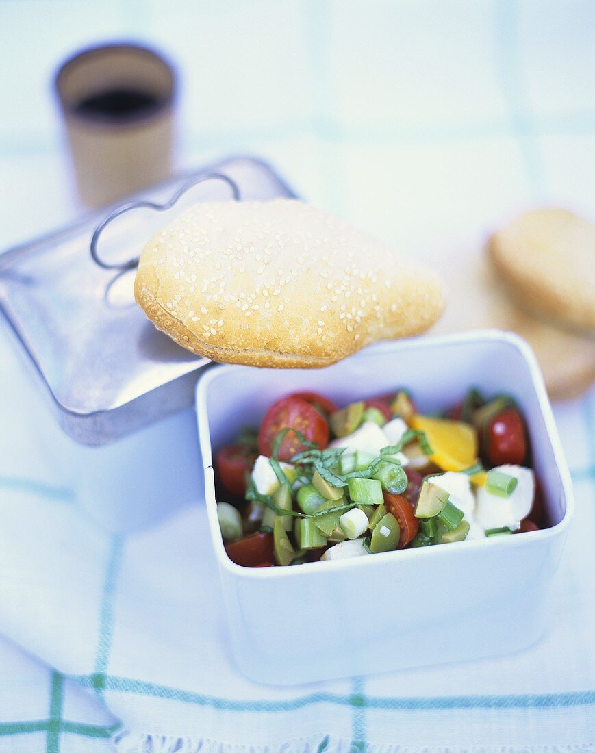Vegetable salad with sheep's cheese and sesame flatbread