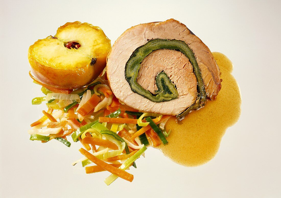 Rolled pork roast with apple, vegetables and beer sauce