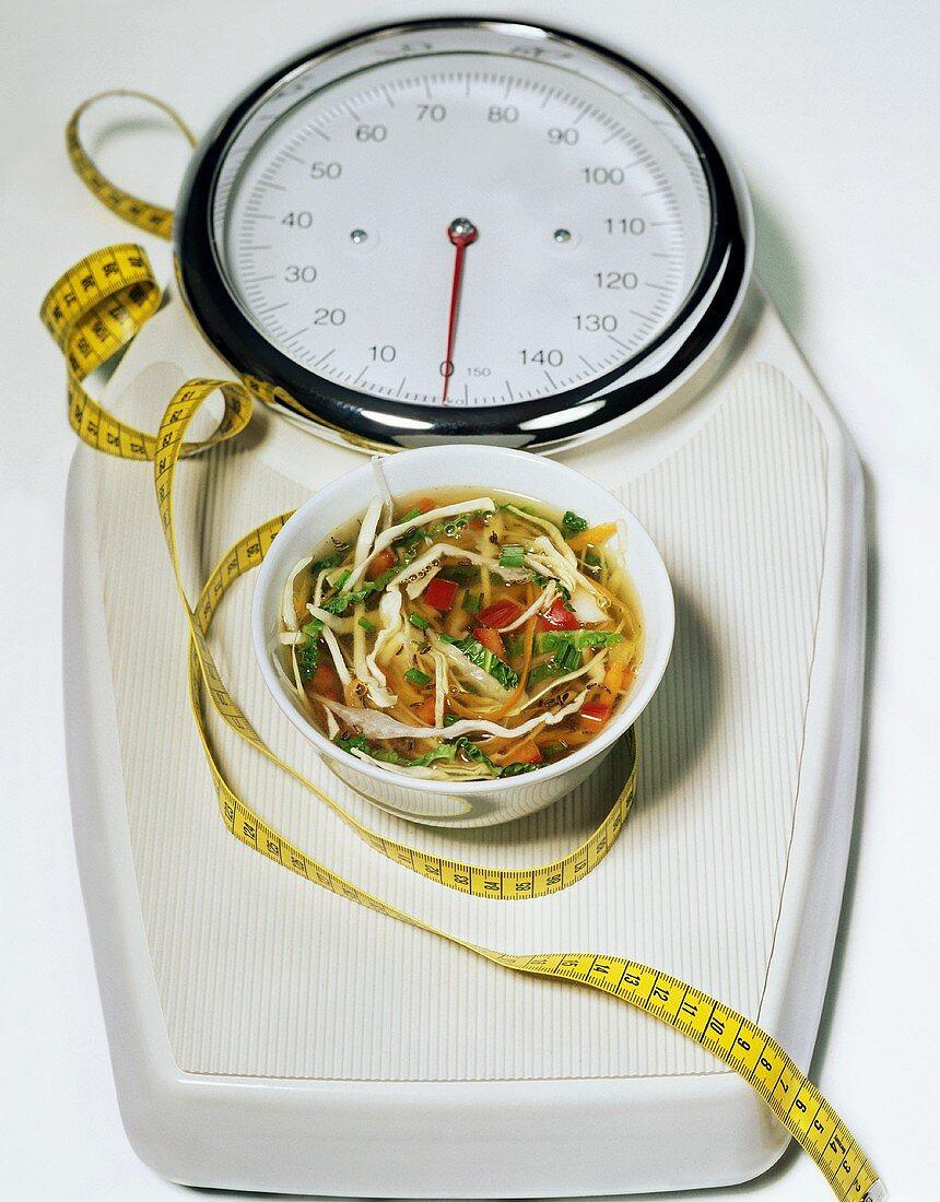 Symbols for Magic Soup Diet: cabbage soup, tape measure, scales