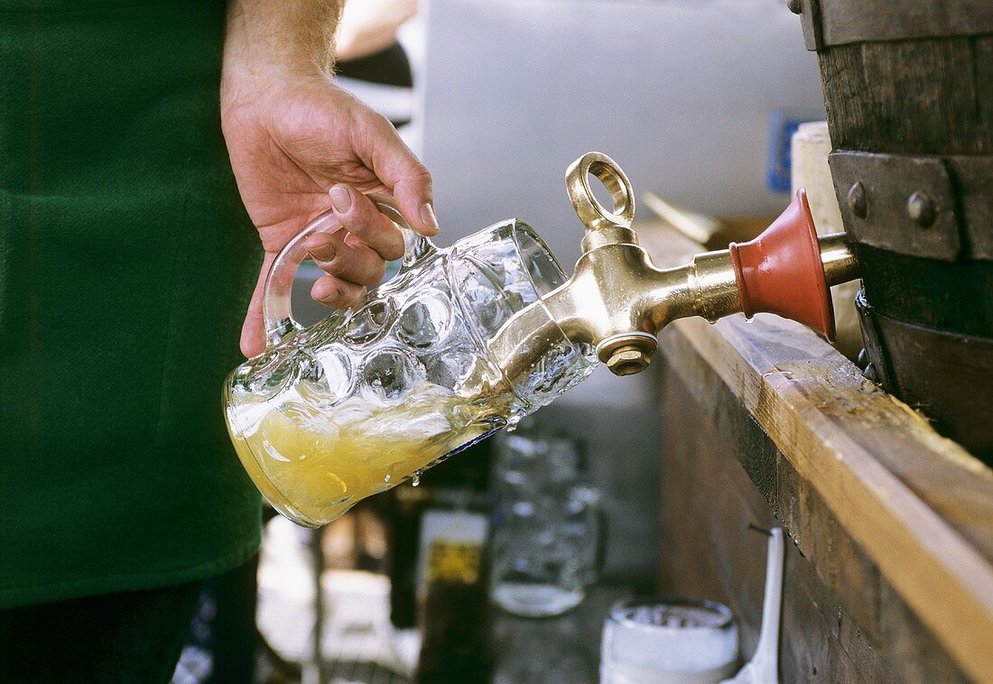 Filling a tankard with draught beer