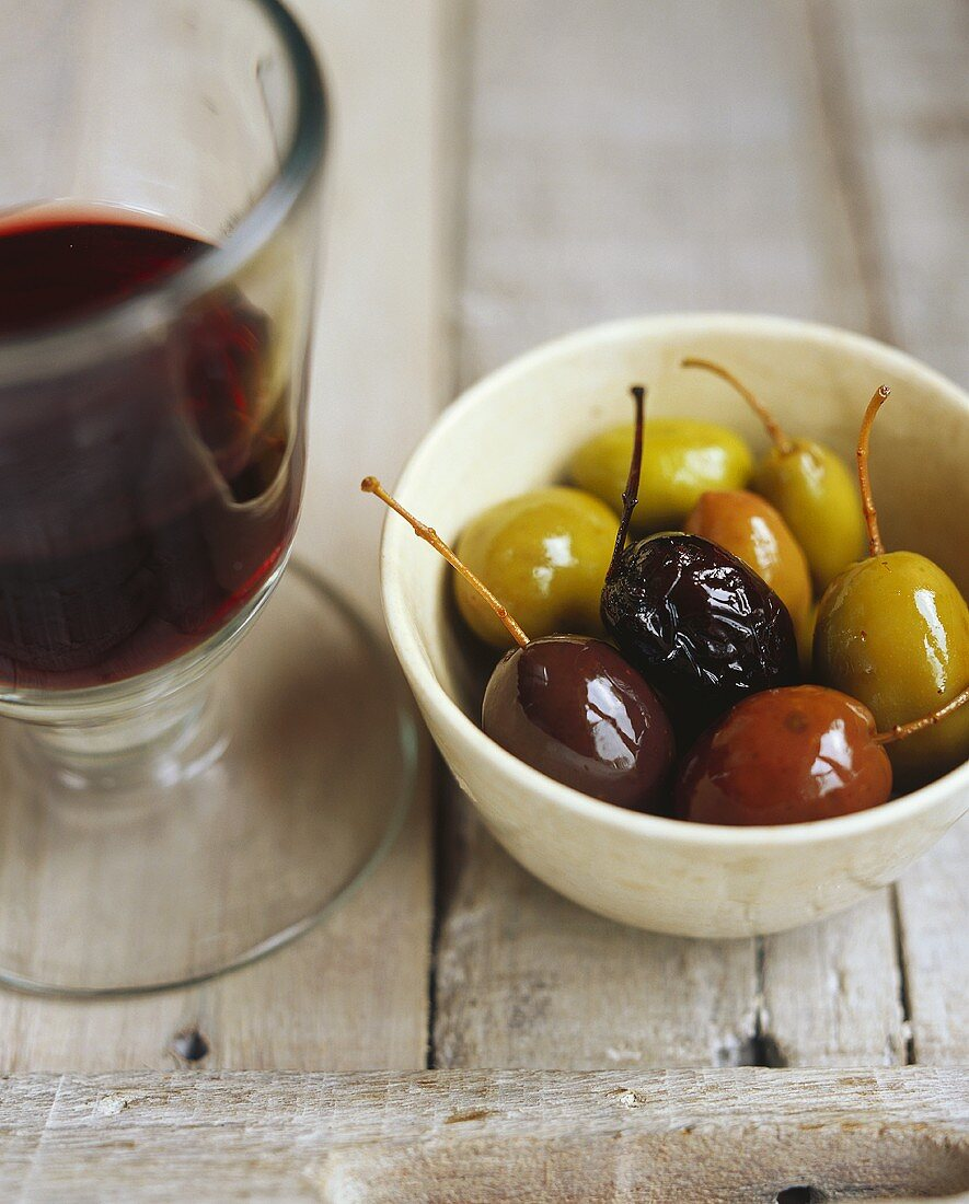 Pickled olives with a glass of wine