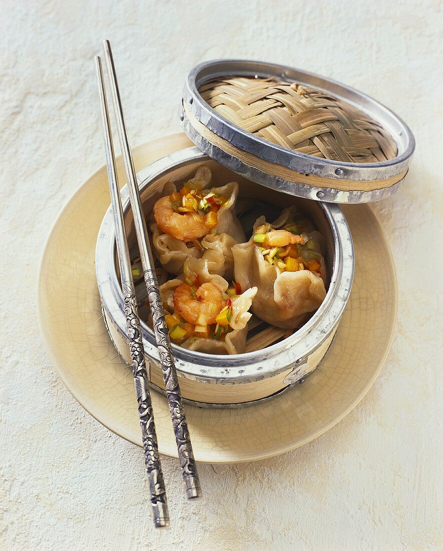 Dim sum with shrimps in small bamboo basket (China)
