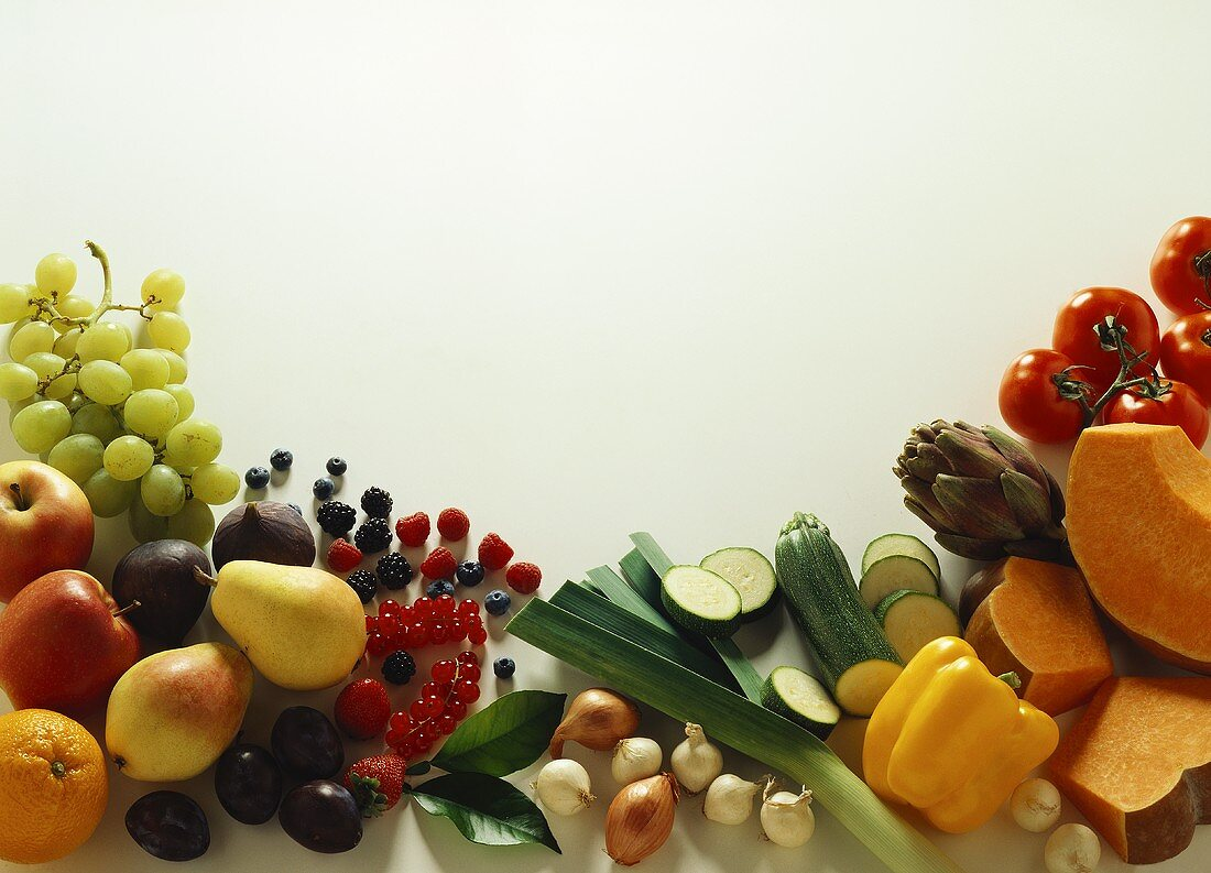 Various types of fruit & vegetables around edge of picture