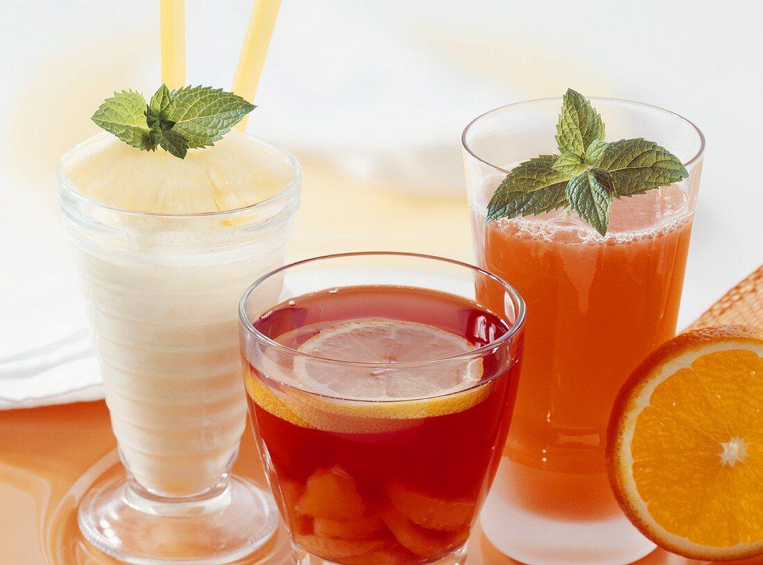 Pineapple-coconut cocktail, fruit punch, orange & ginger drink