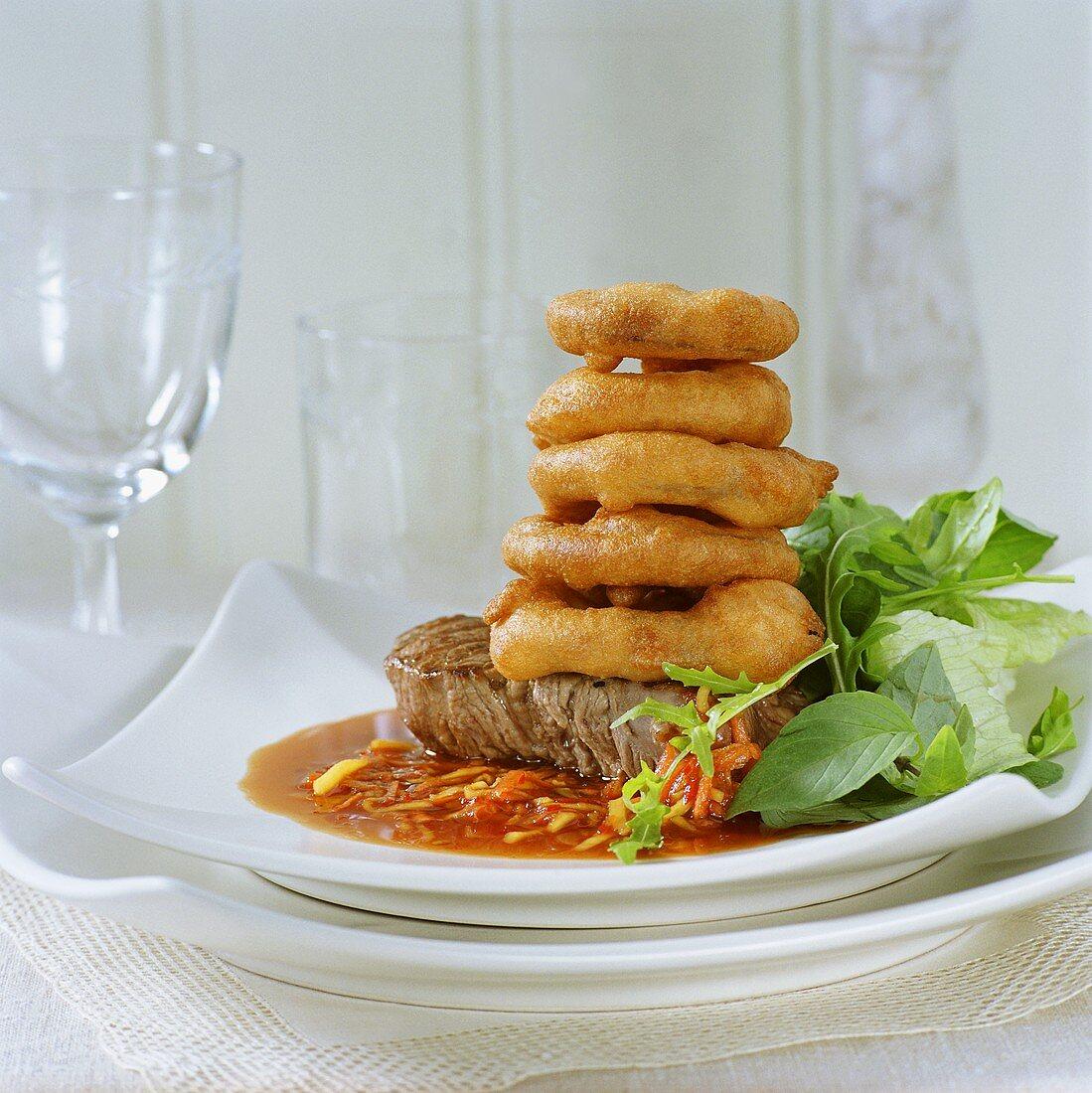 Steak with deep-fried onion rings