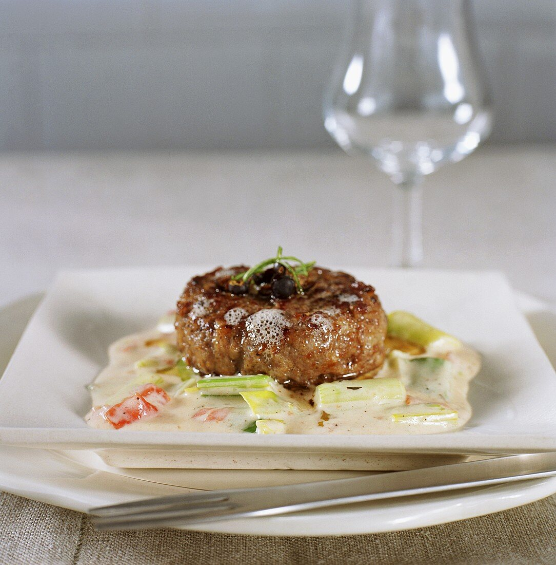 Rissole with juniper berries on creamed vegetables