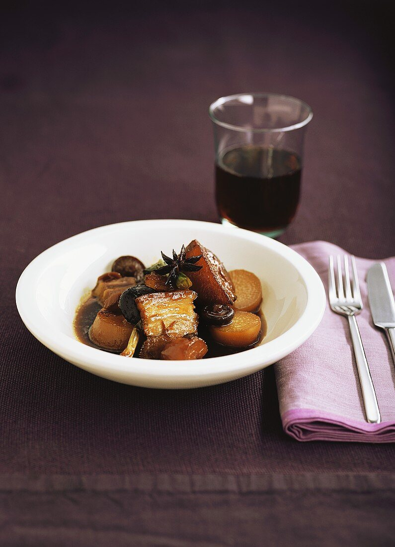 Glazed pork belly with vegetables and mushrooms