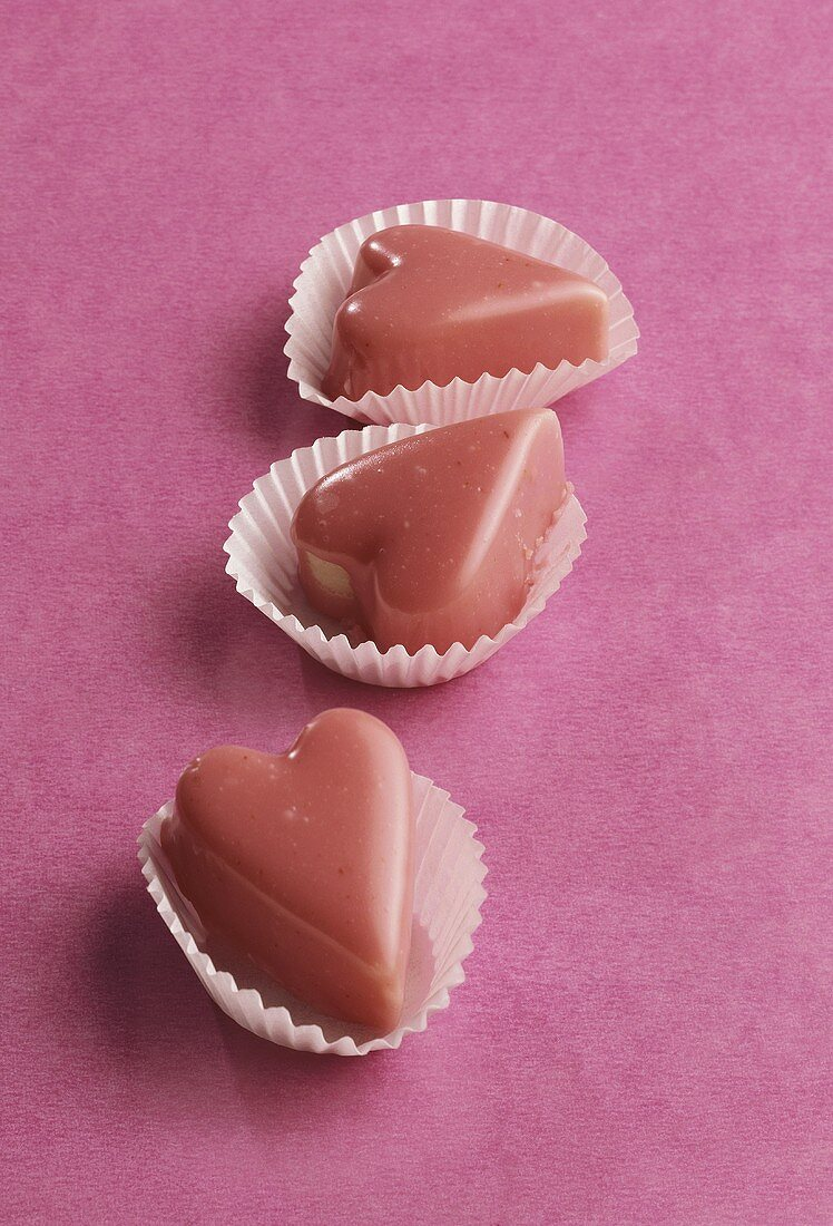 Marzipan hearts with pink glace icing