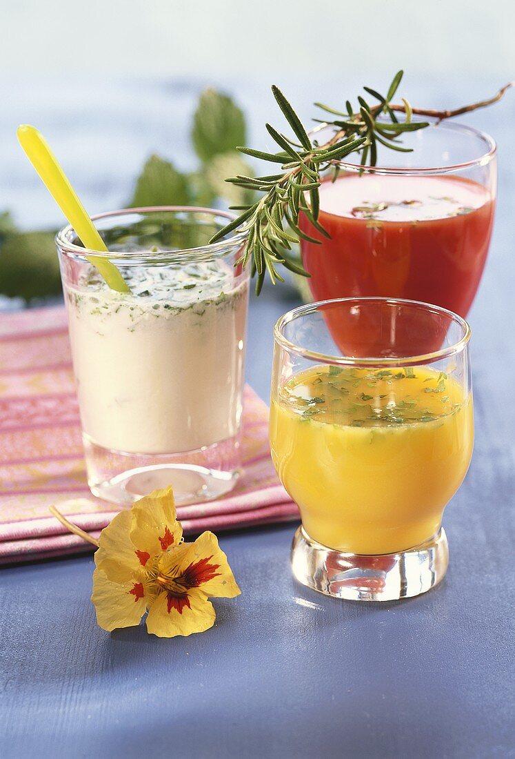 Yoghurt drink, orange juice and tomato juice with herbs