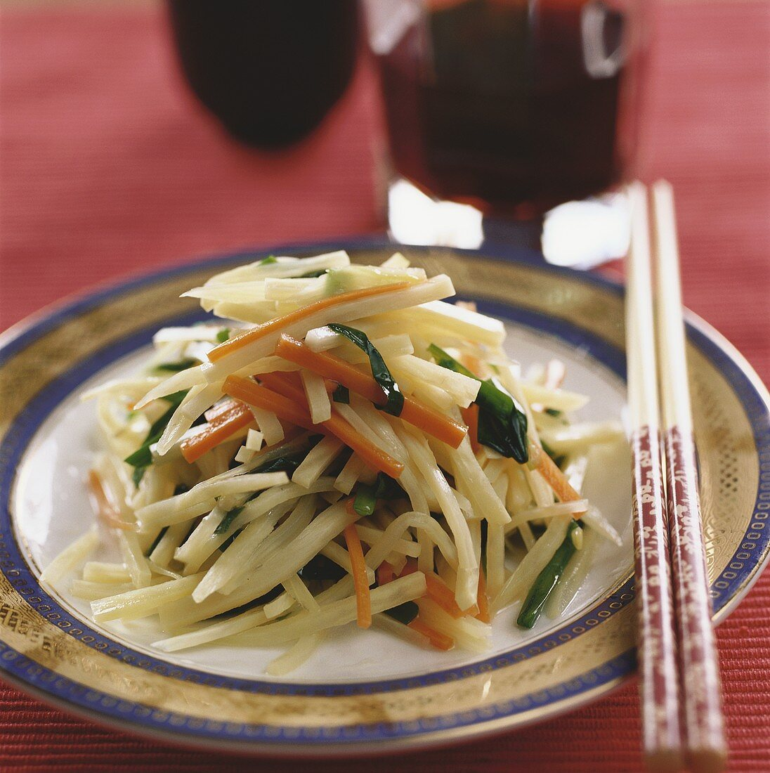Strips of bamboo with carrots and chives (China)