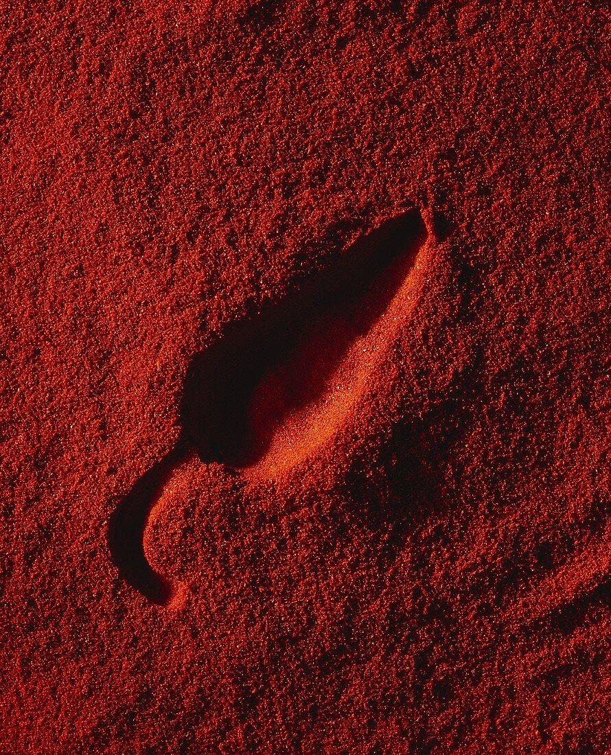 Impression of a cayenne pepper on paprika