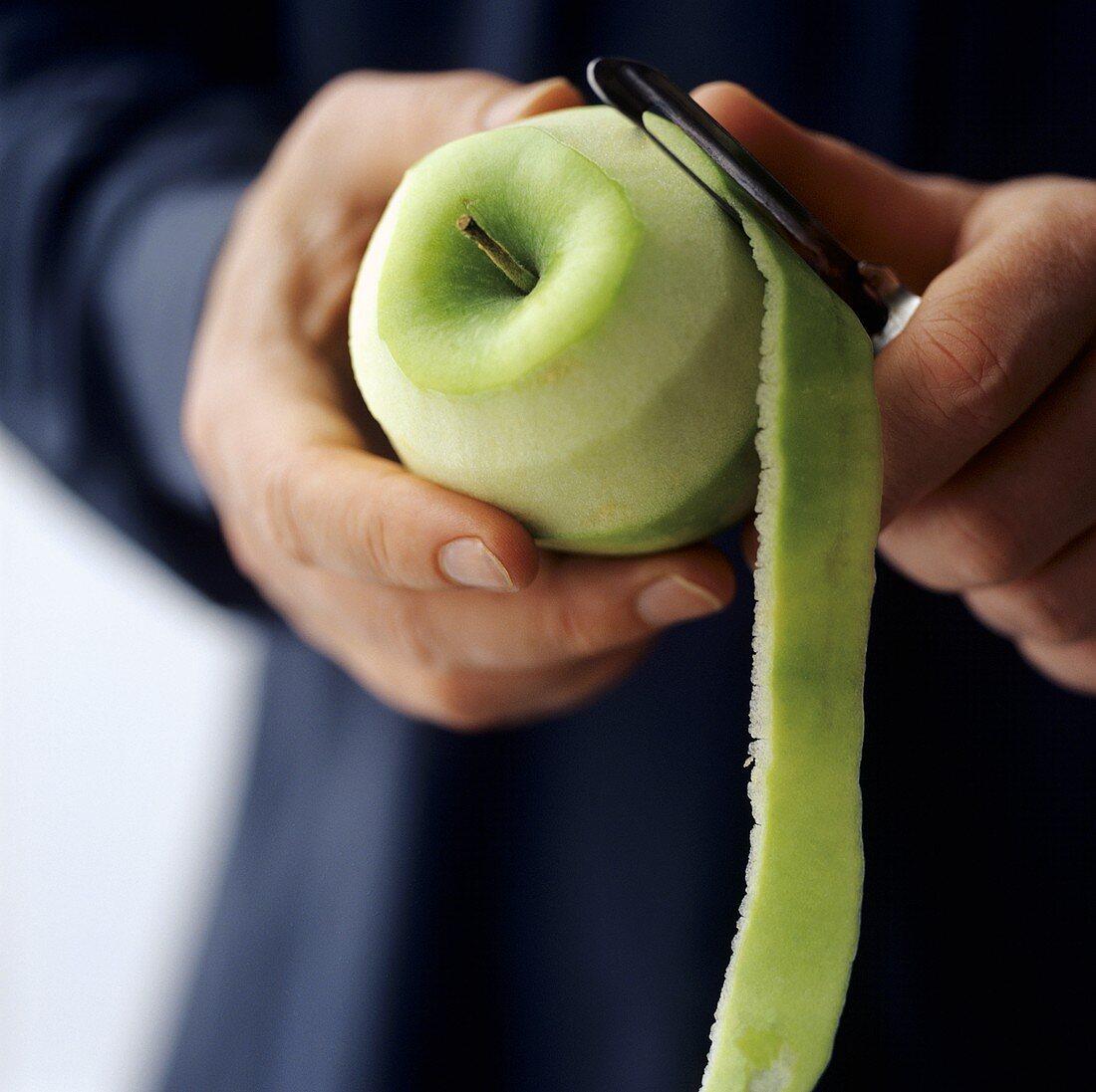 Peeling a Granny Smith apple