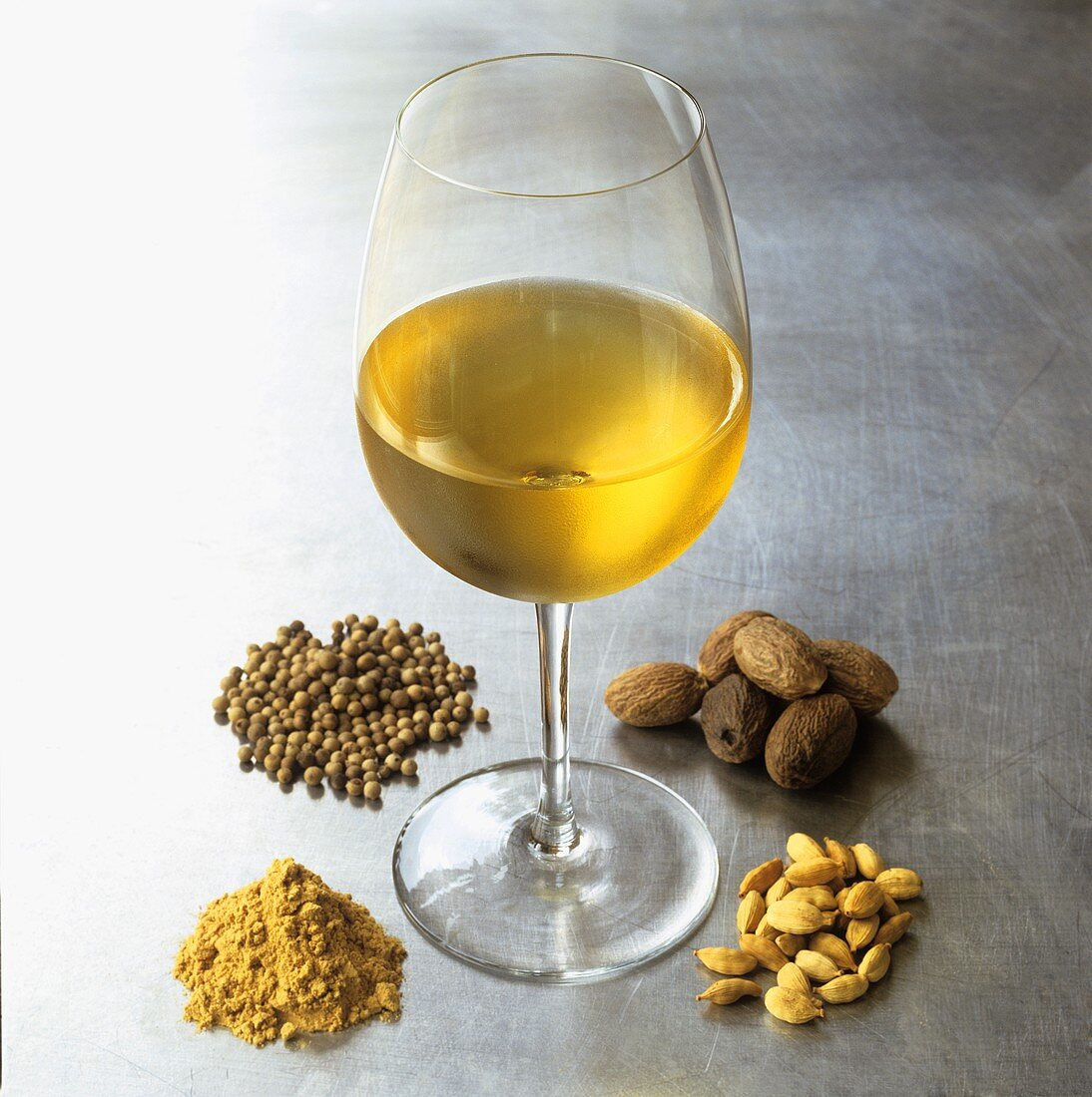 A glass of white wine with aroma components