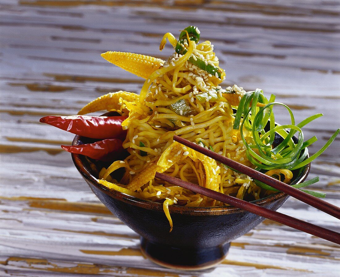 Chinese egg noodles with vegetables and honey sauce