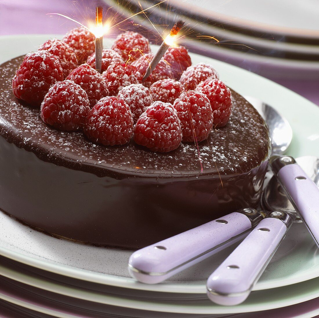 Chocolate cake with raspberries and sparklers