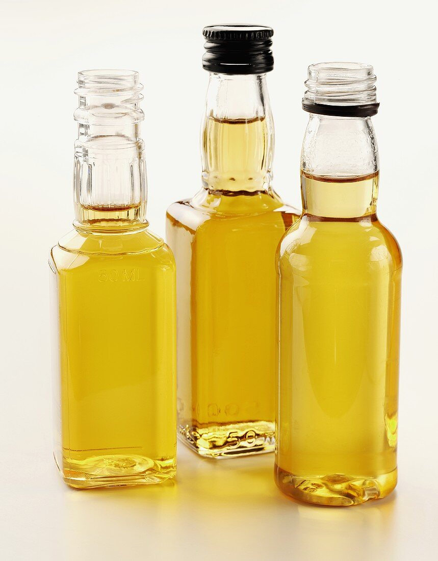 Three small whisky bottles