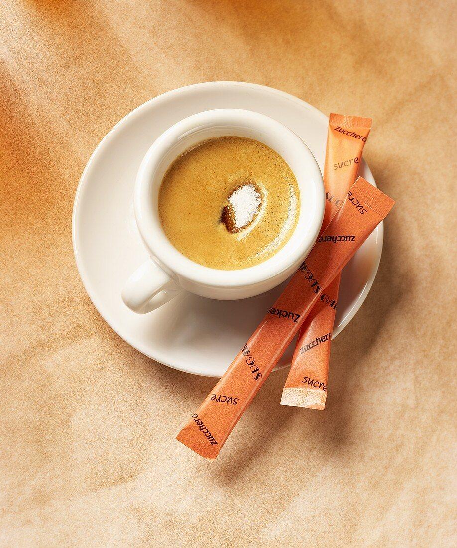 Sugar sinking into frothy espresso
