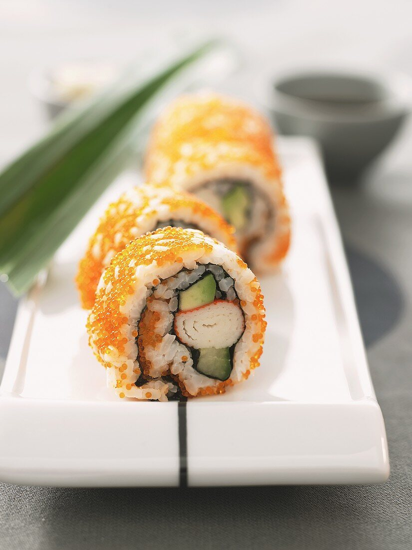 California rolls with caviare on a platter