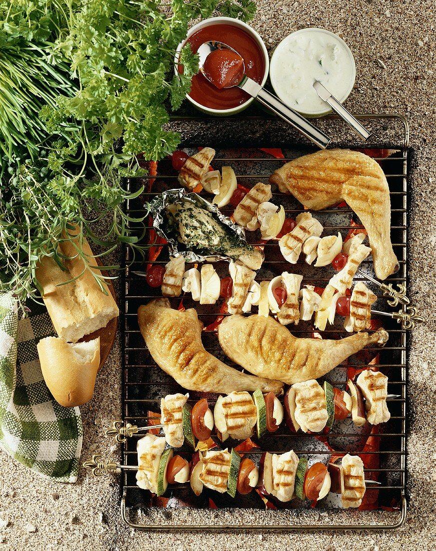 Grill rack with kebabs and chicken legs