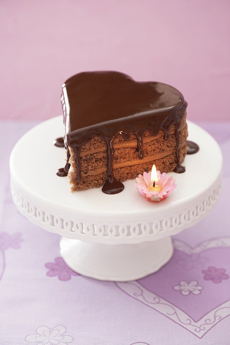 Heart-shaped chocolate cake with a candle