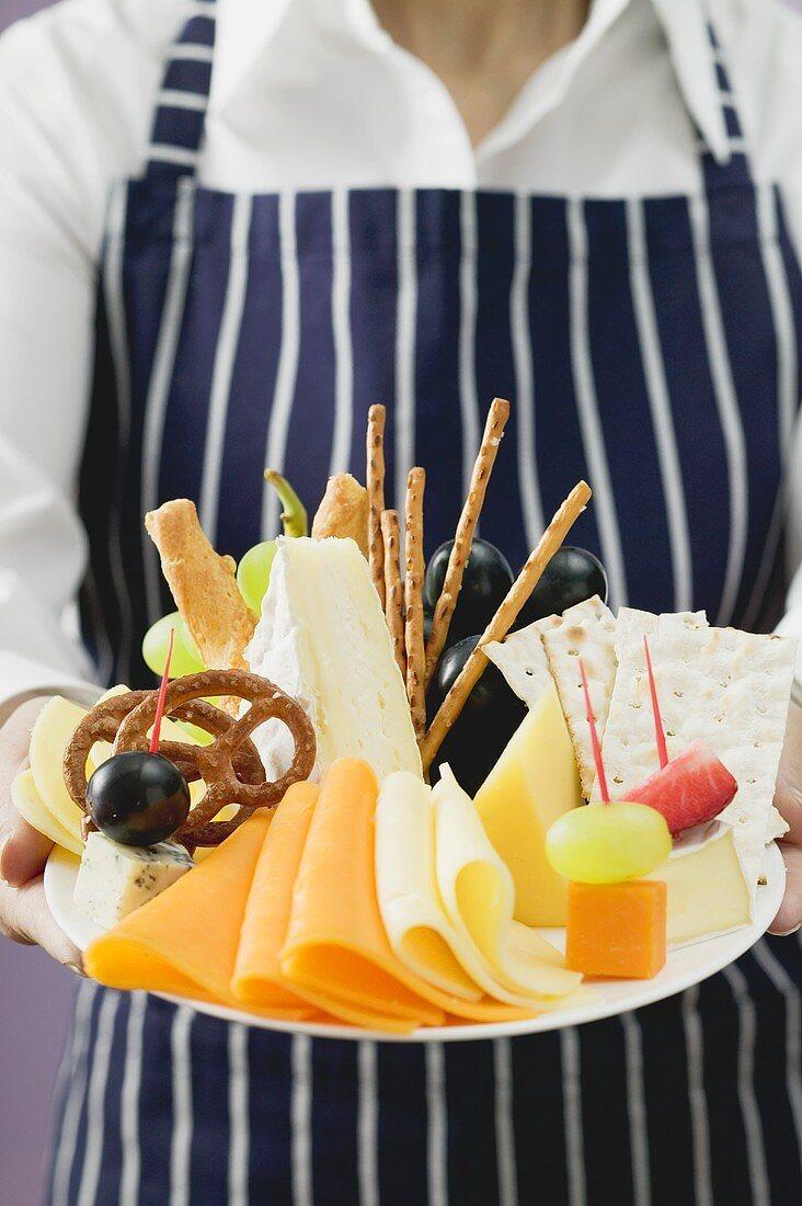 Waitress serving cheese platter