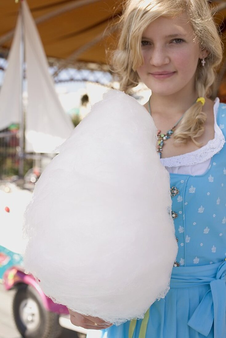 Girl with candyfloss at Oktoberfest in Munich, Germany