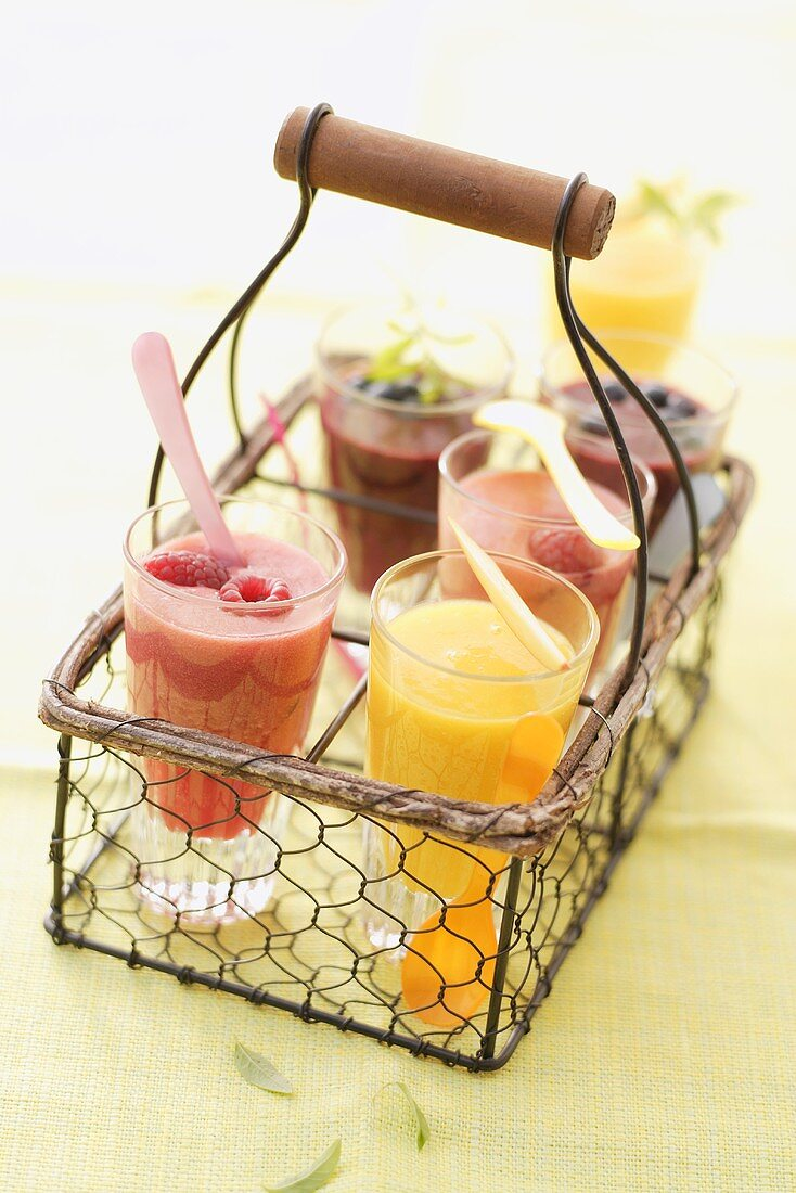 Assorted fruit smoothies in a bottle carrier