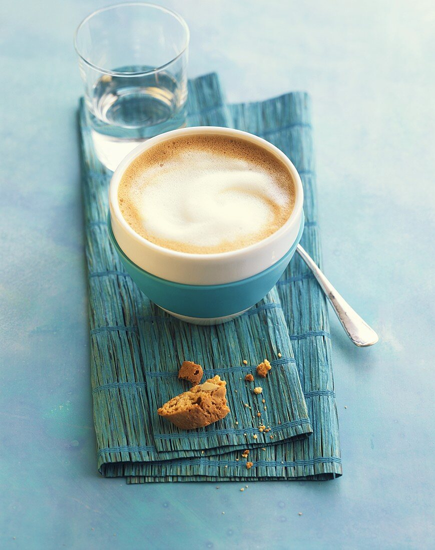 Milky coffee in a blue and white striped bowl