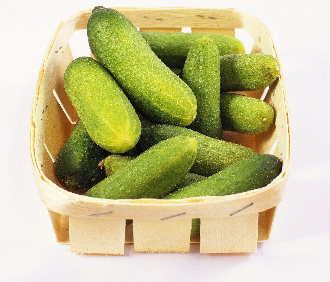 Pickled gherkins in a wooden basket
