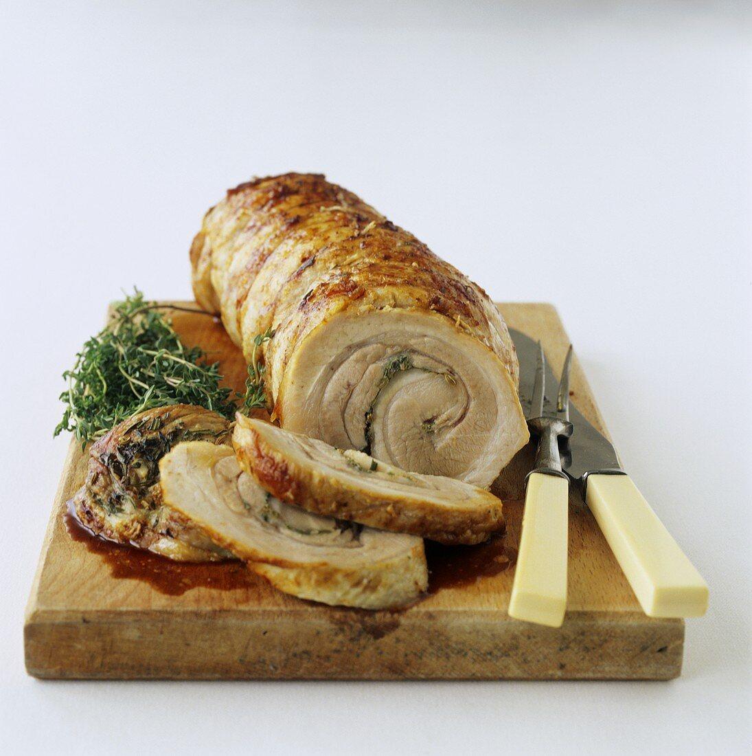 Roast pork roll, slices carved