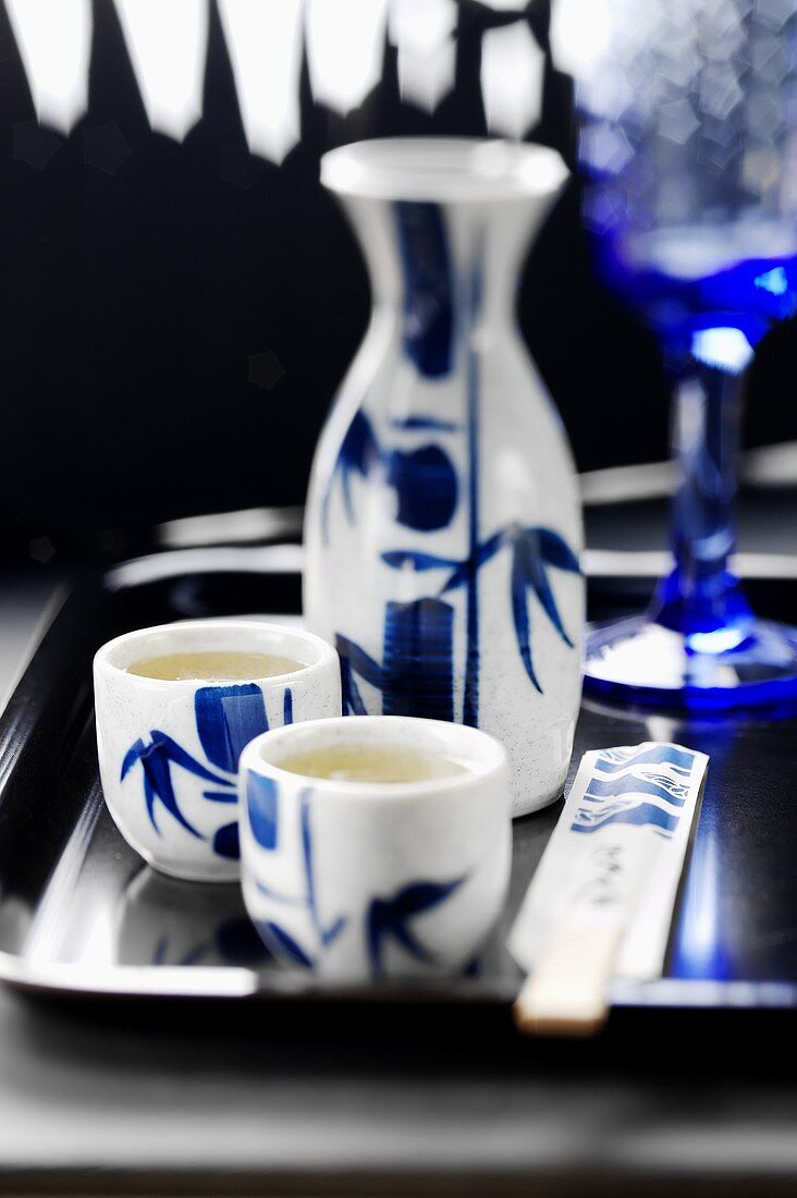 Two cups and a carafe of rice schnapps (China)