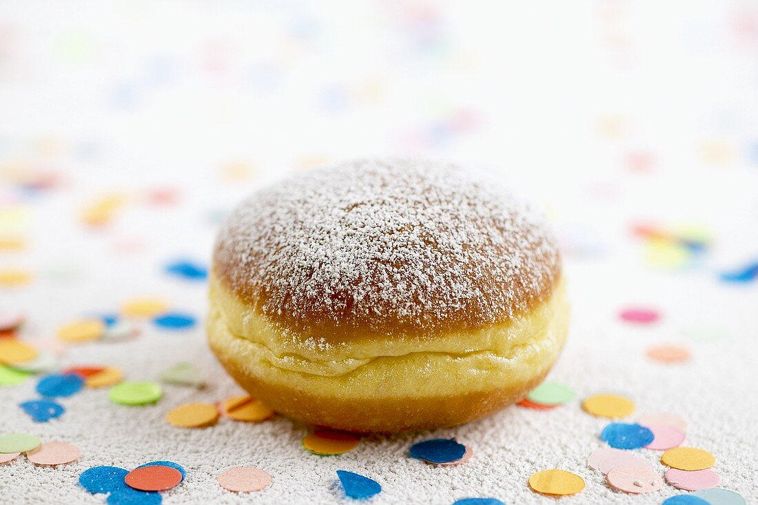 Doughnut surrounded by confetti
